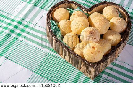 Cheese Bread, Heart-shaped Basket Lined With Green And White Fabric Filled With Cheese Bread On A Ch