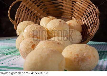Cheese Bread, Fallen Straw Basket With Cheese Bread On A Checkered Tablecloth, Selective Focus In Th