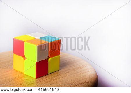 Araras, São Paulo, Brazil, April 4, 2021, Magic Cube Easy Level On Wood, White Background, Selective