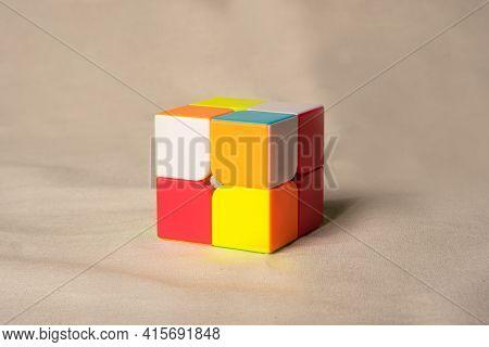 Araras, São Paulo, Brazil, April 4, 2021, Magic Cube On Beige Fabric, Selective Focus.