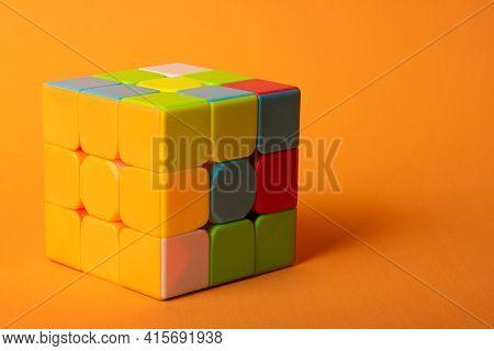 Araras, São Paulo, Brazil, April 4, 2021, A Magic Cube With A Correct Face On An Orange Background A