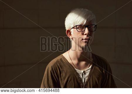 Portrait Of European Albino Boy Wearing Glasses