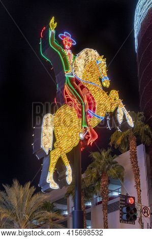 Las Vegas, Usa - March 9, 2019: The Famous Fremont Street Hacienda Horse And Rider Sign Glows Bright