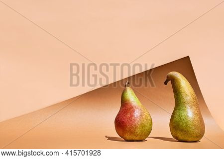 Funny Fruits On Colorful Pastel Background. Two Pears Like People In Conversation