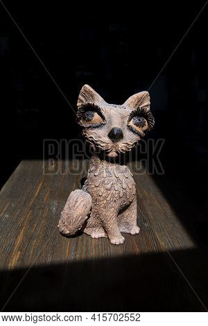 Sofia, Bulgaria. 05.25.2018. A Wooden Cat Figurine Stands In A Bright Spot Of Morning Sunlight. The