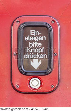 Vienna, Austria - April 28, 2015:  Sign For Entrance Please Press Button (german: Einsteigen Bitte K