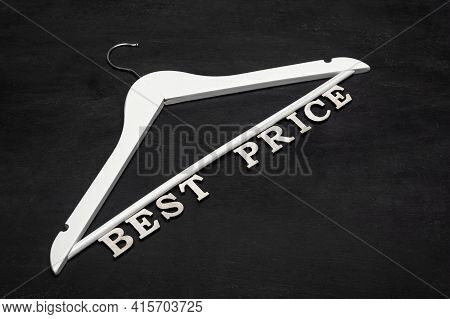 White Hanger And Best Price Inscription On Black Background. Discounts. Seasonal Sale. Special Offer