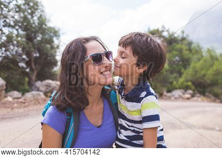 Portrait Of A Boy With Mom On A Background Of Mountains, A Woman Travels With A Child, A Child Hugs