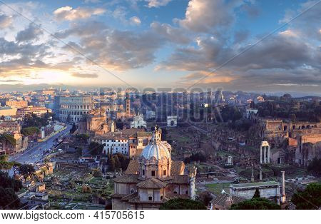 Ruins Of Roman Forum. Rome City Evening View From Ii Vittoriano Top. People Are Unrecognizable.