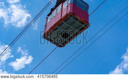 Old Waggon Moves Along Cable Car In Sunny Weather