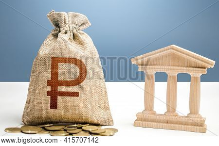 Russian Ruble Money Bag And Bank / Government Building. Budgeting, National Financial System. Lendin