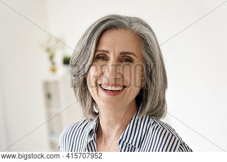 Cheerful Satisfied 50s Mature Woman Laughing Looking At Camera At Home. Happy Sophisticated Classy M