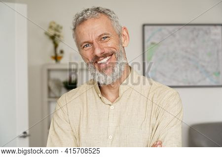 Smiling Relaxed Mature Older Bearded Hipster Man Looking At Camera. Happy Handsome Confident Middle