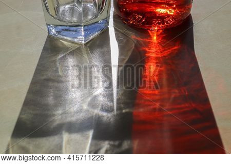 Sunlight Shining Through A Drinking Glas Showing Caustic Light Effects