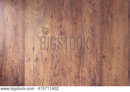 Laminate floor background texture.   Wooden laminate floor or wood wall with copy space