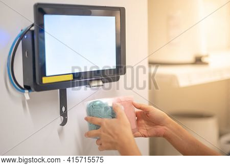 Female Hand Holding Goods Scanning Barcode On Information Machine For Check The Price And Informatio