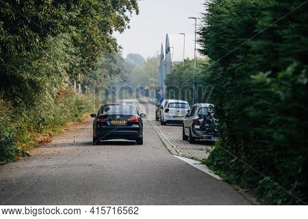 Haarlem, Netherlands - Aug 28, 2019: Rear View Of Black Volkswagen Car Driving On The Almost Empty R