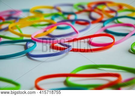 Side View Of Colorful Rubber Bands On White. Rainbow Elastic Rubber Bands On White.
