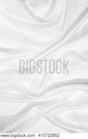 Texture Of White Silk Cloth, Textile Background, Drapery And Pleats On Delicate Fabric. Hard Light A