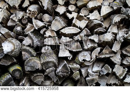 Background Of Dry Chopped Firewood Logs. Pile Of Wooden Logs. Wall Of Stacked Wood Logs. Neatly Stac