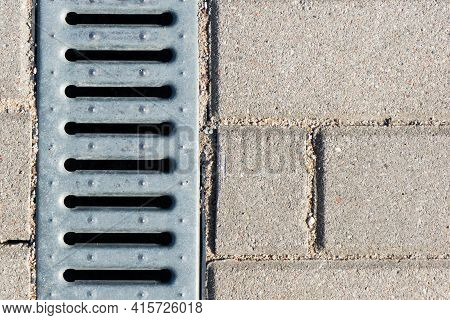 Manhole On Concrete Drain System Cover. Urban Sewer Background. Metal Drain Cover Texture. Pavement