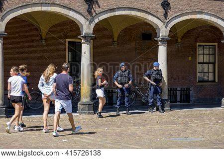 The Hague, Netherlands - July 03, 2018: Tourists And Police Patrol In The Binnenhof Compound - The R