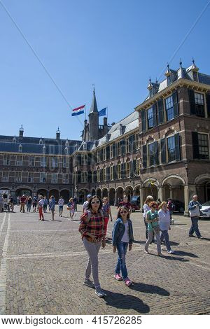 The Hague, Netherlands - July 03, 2018: A Group Of Tourists On The Grounds Of The Binnenhof - The Re