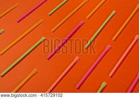 Drinking Straws On An Orange Background. Cocktail Straw. Top View.
