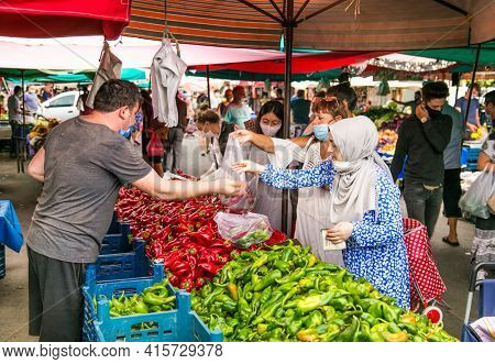Alanya , Turkey- October 20, 2020: Unidentified people  with protective mask  trade on the street market in Alanya, Turkey.