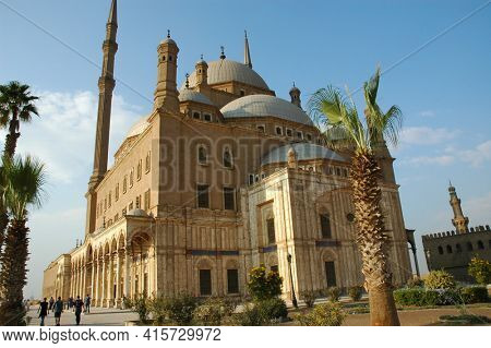 Cairo - OCTOBER 28:  Tourists gather at the Ottoman-style Muhammad 'Ali Mosque or Alabaster Mosque, Cairo, Egypt October 28, 2008. Completed in 1848 it dominates the skyline.