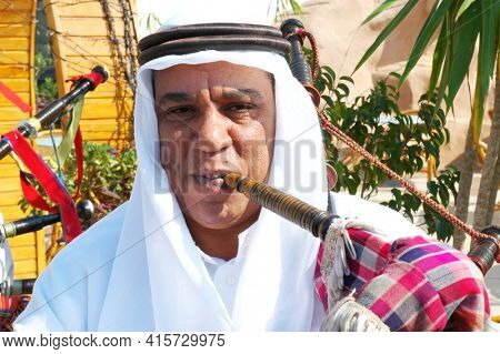 Luxor, Egypt - OCTOBER 30: Egyptian Bagpipe Player performs outside tourist attraction at Luxor, Egypt on October 30, 2008. Local entertainers frequently perform at tourist attractions.