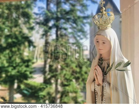 Virgin Mary Statue Praying With Her Hands Joined ,with A Crown. Our Lady Of Fatima. Paray-le-monial,