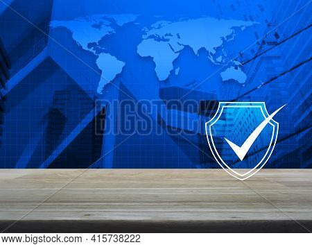 Security Shield With Check Mark Flat Icon On Wooden Table Over World Map, Modern City Tower And Skys