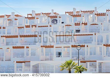 Exterior View Of White Apartments In Spain.