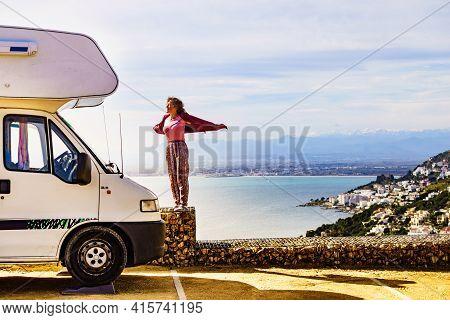 Mature Tourist Woman Enjoy Caravan Vacation. Punta Falconera Location With View Of Gulf Of Roses, Pr