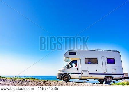 Camper Rv Caravan On Mediterranean Coast In Spain. Wild Camping On Sea Shore. Holidays And Travel In
