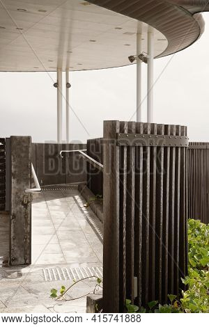 Close Up Of The Curved Architectural Design Of Timber Posts On An Outdoor Beachfront Viewing Platfor