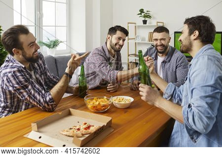 Home Gathering And Feasting With Beer And Pizza For Male Company