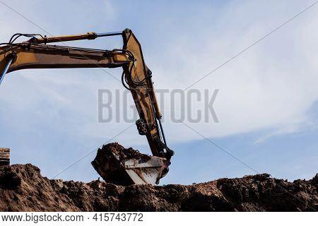 Huge Heavy Shovel Excavator Digger On Gravel Construction Site On Sky Background