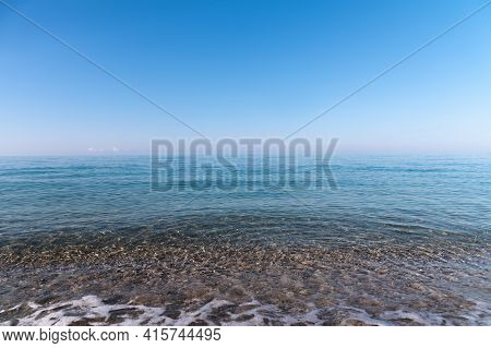 Calm Morning Sea. Small Waves In Calm Conditions. Sea Background