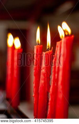 Lit Candles Inside A Church