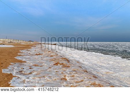 Schaslyvtseve, Ukraine - February 20, 2021: This Is The Azov Beach Coast On The Arabat Spit In Winte