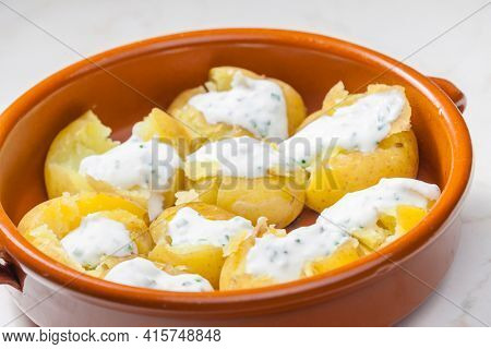 baked potatoes with yoghurt sauce and chive
