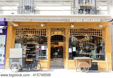 Paris, France-31 March, 2021 : The Traditional French Bakery Shop A La Fontaine Du Mars Located Near