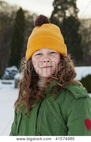 Teenager Girl In A Snowy Park