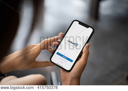 Chiang Mai, Thailand, Apr 05, 2021 : A Women Holds Apple Iphone With Linkedin Application On The Scr