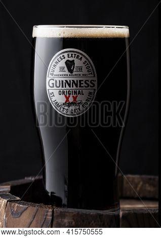 London, Uk - April 27, 2018: Original Glass Of Guinness Original Stout Beer On Top Of Old Wooden Bar