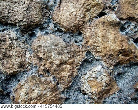 Rough And Rough Texture Of The Stone With Depressions On The Surface