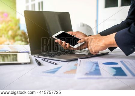 Hand Using Mobile Phone In Office Work ,man Using Smartphone In Work