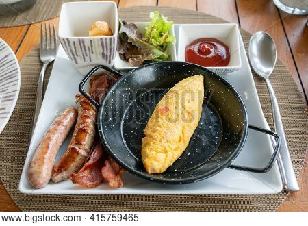Classic Western Breakfast Plate With Omelette, Sausages And Bacons